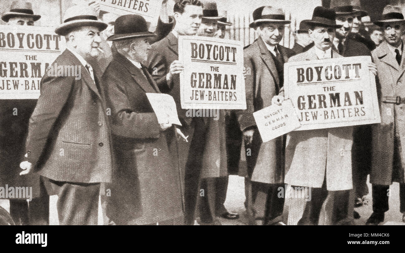 A group of Jews protesting against Hitler's anti-Jewish doctrine assembled in Hyde Park, London, England in 1933 holding signs which read 'Boycott the German Jew- Baiters'.  From The Pageant of the Century, published 1934 - Stock Image