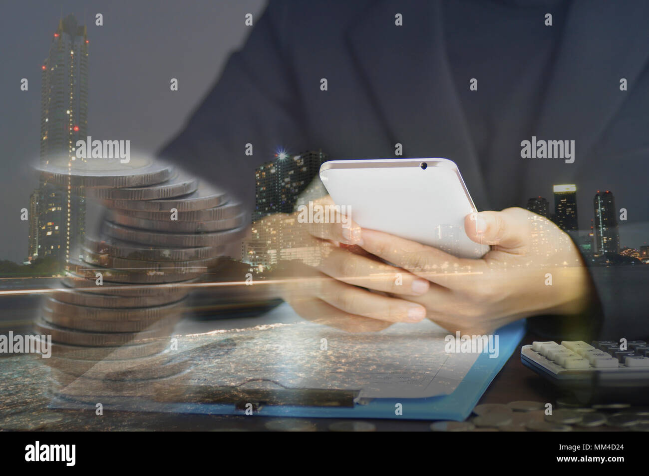 double exposure women use phone on desk and night city, concept in comunicate and contact in finace, account and business - Stock Image