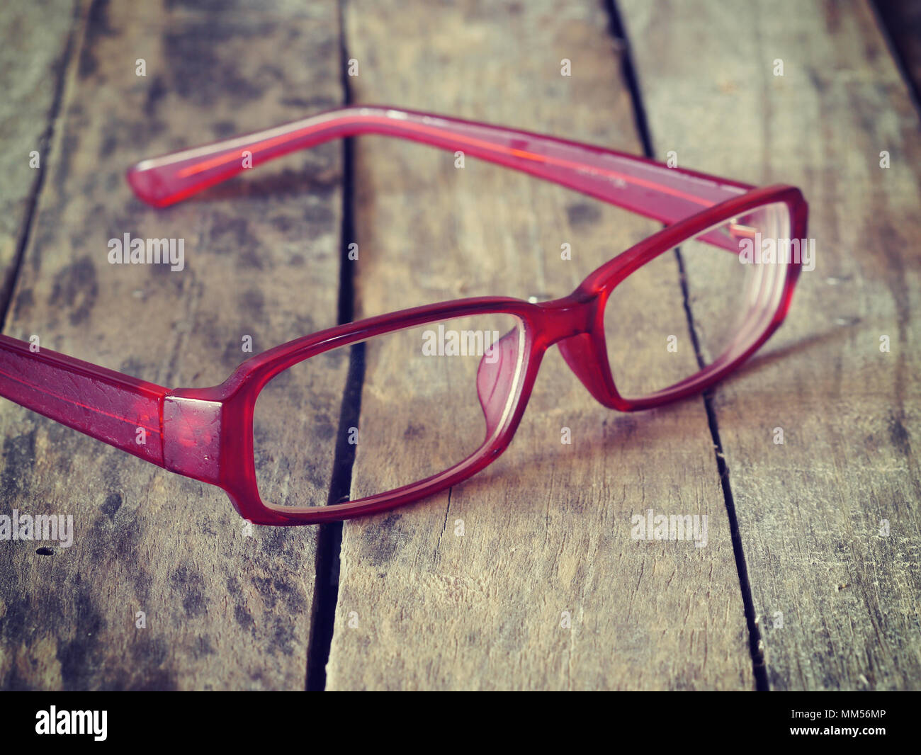 red glasses on wood background retro-vintage style - Stock Image