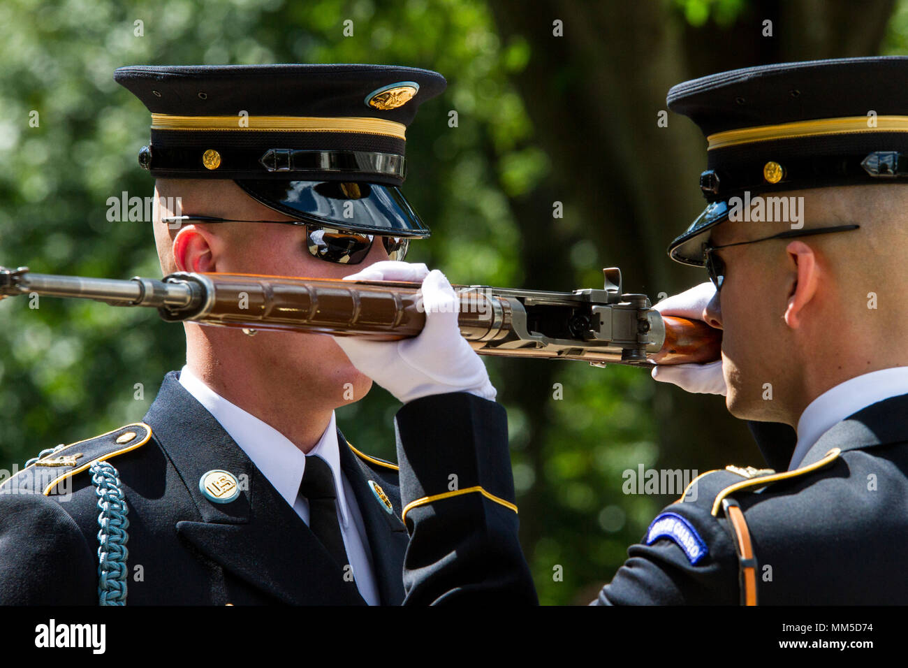 A relief commander conducts an inspection of a sentinel's rifle during the changing of the guard at the Tomb of the Unknown Soldier at Arlington National Cemetery in Arlington, Virginia, Sept. 7, 2017. Noncommissioned officers with the 200th Military Police Command, out of Fort Meade, Maryland, visited the national cemetery as part of their monthly NCO professional development training. The visit included a guided tour of the grounds by an Arlington National Cemetery historian, who showed Soldiers how to use the ANC mobile app to locate specific tombs and biographies of individuals buried at A - Stock Image
