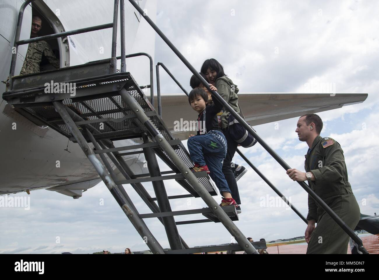 The Tusgumori family steps into an aircraft during the Pacific