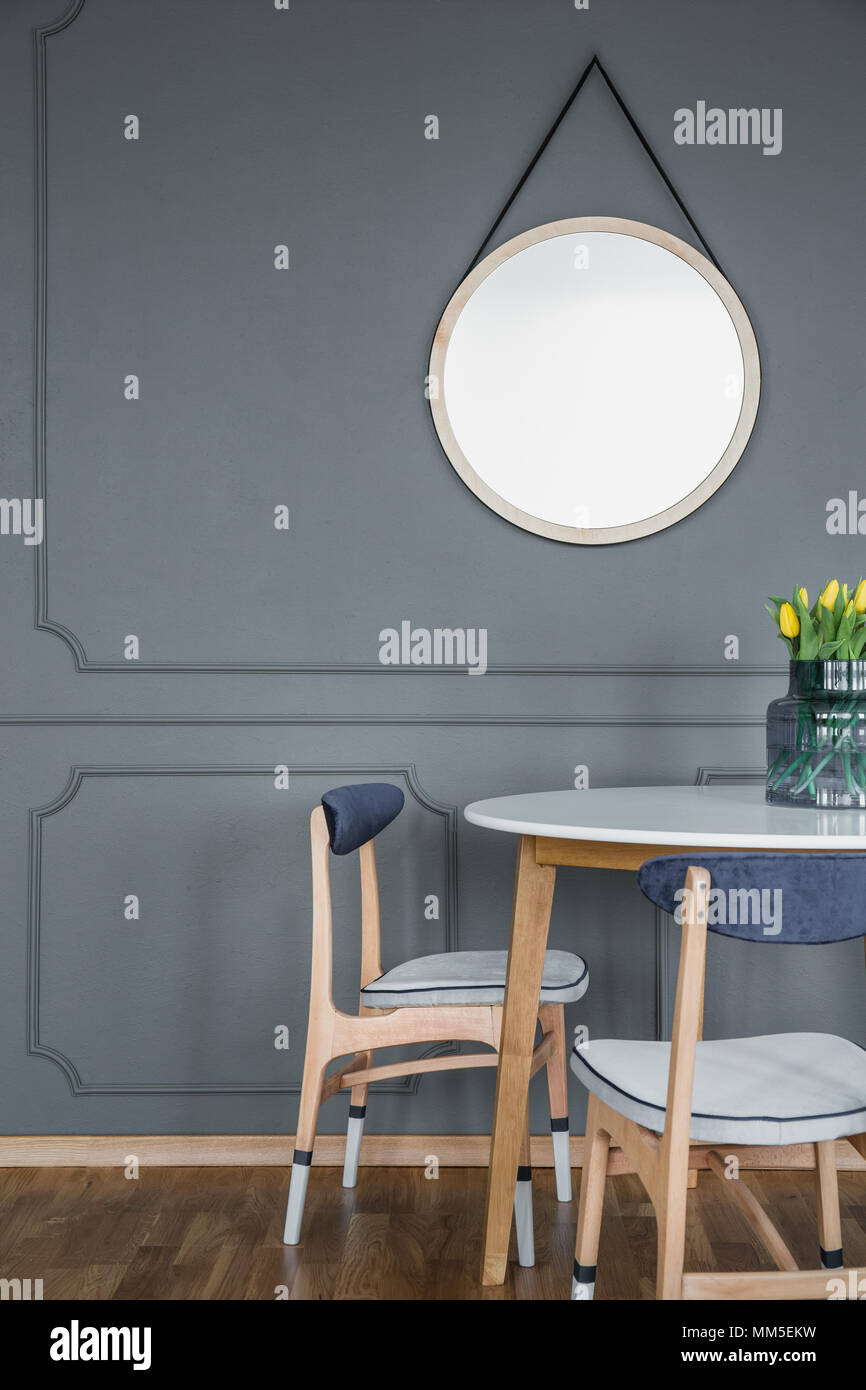 Grey Dining Room Interior With Mirror Round Table Chairs And Wall Molding Stock Photo Alamy