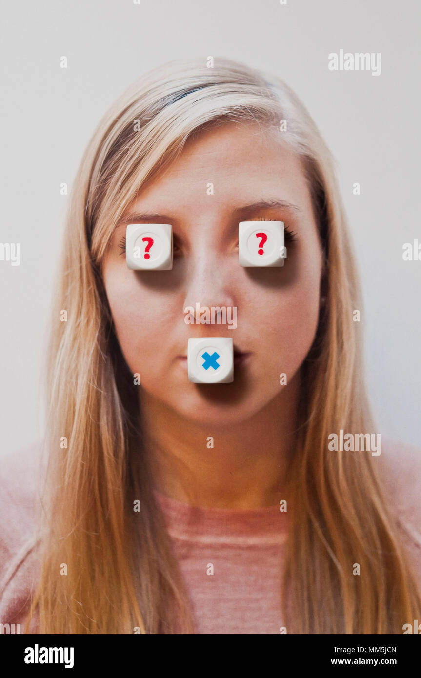 Photo Of A Photo Of A Blond Teenager Girl With Dice Over Her Eyes And Mouth