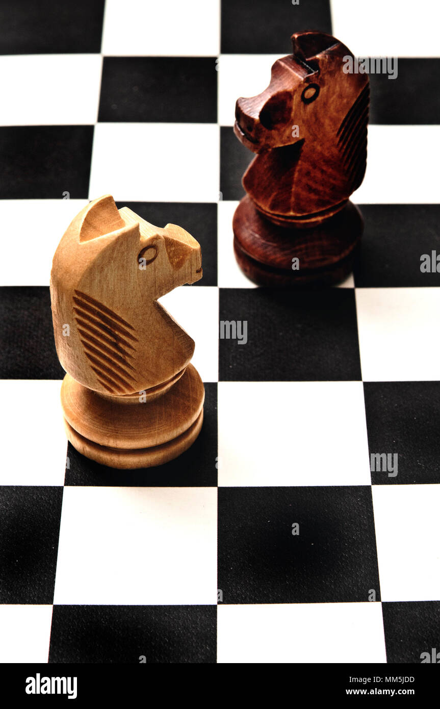 two chess knights on the chessboard, confronting each other. Challenge or decisions concept Stock Photo