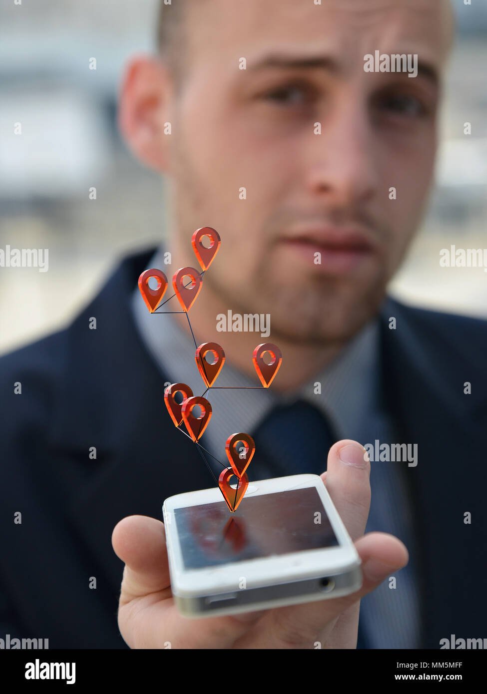 man using geotags on smartphone - Stock Image