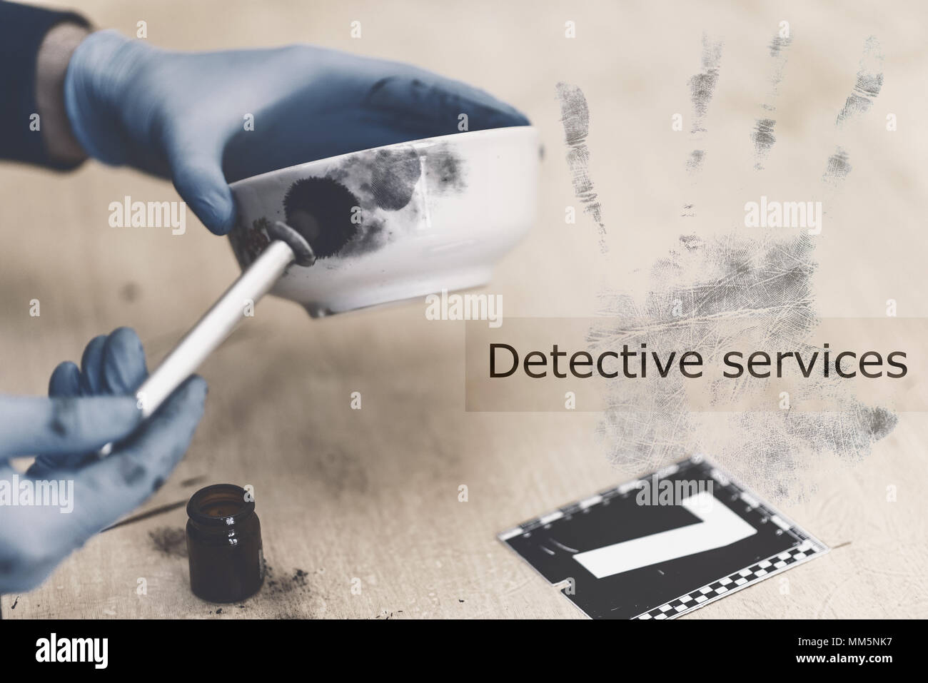 Detective services. Specialist conducting searches and takes samples of fingerprints at the crime scene, investigation - Stock Image