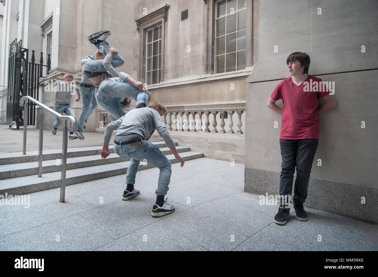 Free running parkour athlete jumping of stairs in public area, London, England - Stock Image