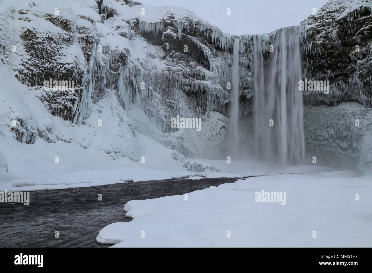 Skogafoss waterfall frozen, a treasure in Iceland - Stock Image