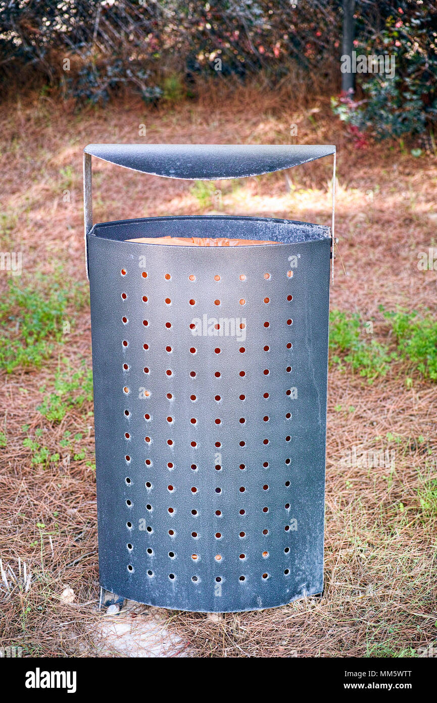 Public garbage can in park. Close-up. - Stock Image