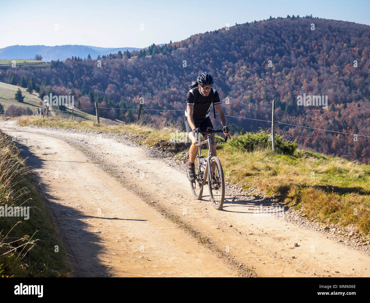 Cyclocross rider on cycling tour near Grand Ballon, Vosges, France - Stock Image
