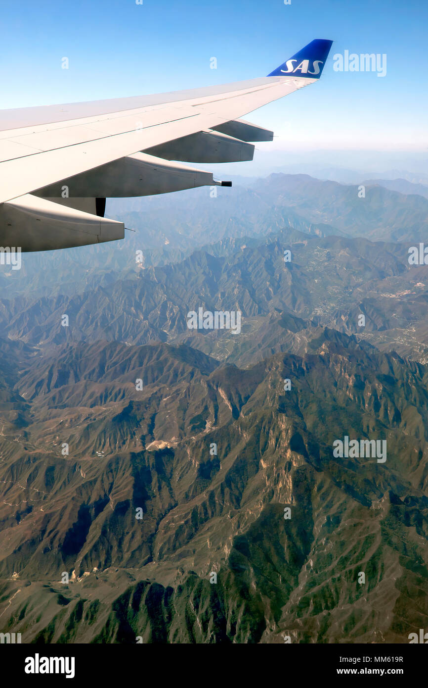 Wingtip / wing tip / winglet of a Scandinavian Airlines / SAS passenger jet, 30 minutes from Beijing Capital International Airport, China - Stock Image