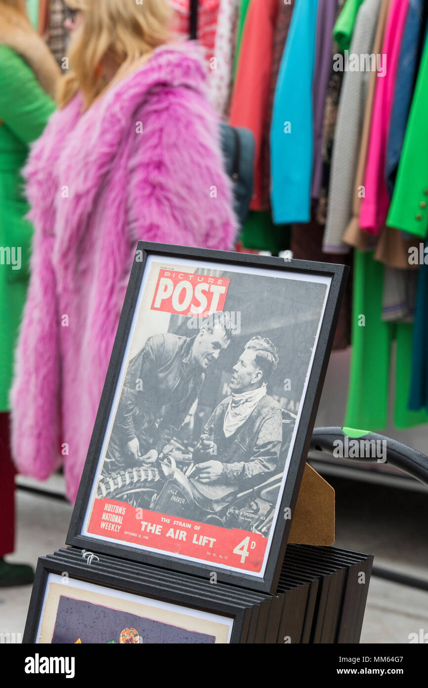 Framed picture post magazine in front of vintage womens clothing rack at a retro vintage car boot sale. Granary Square, Kings Cross, London - Stock Image