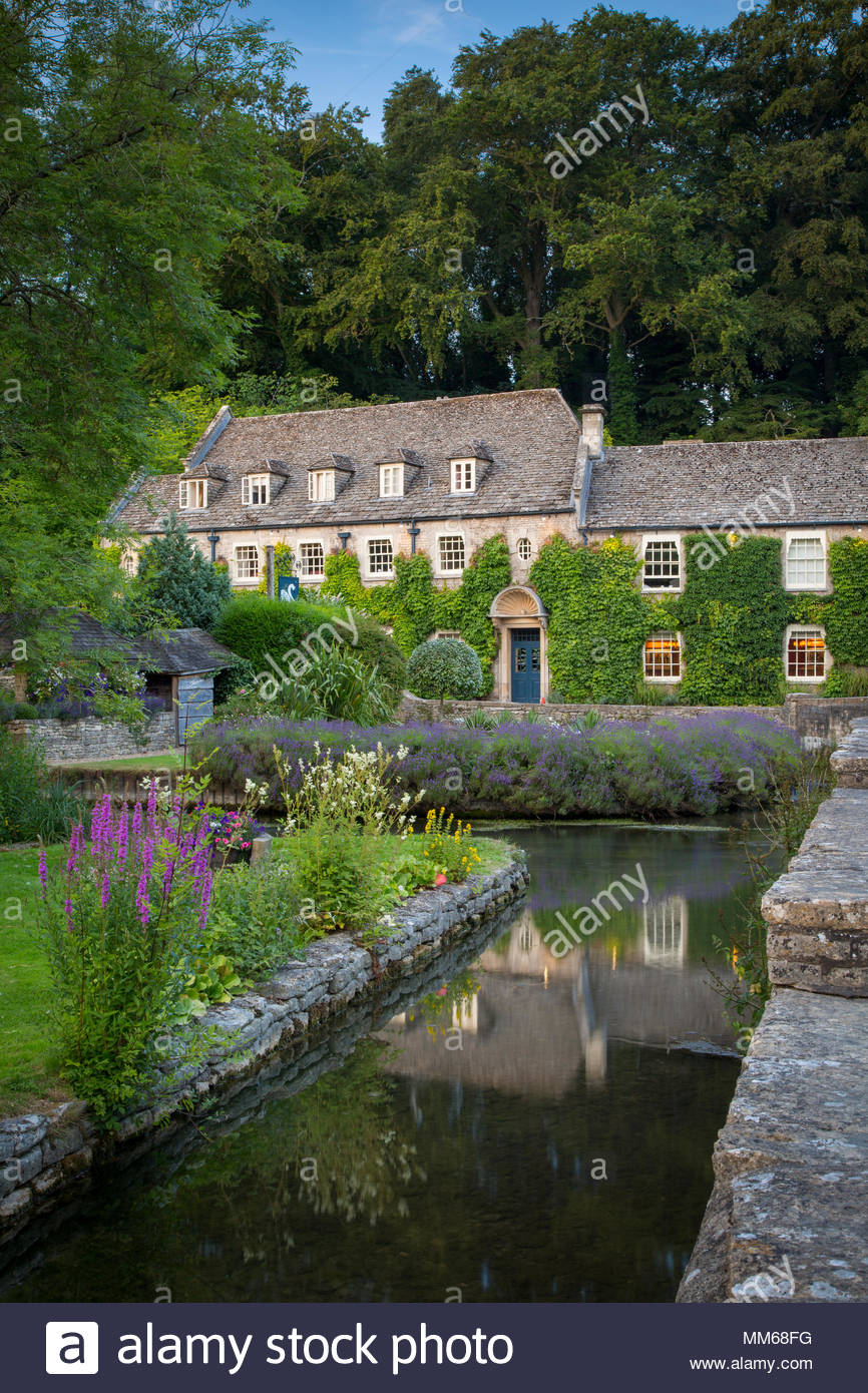 Evening at Swan Hotel - a 17th Century Coaching Inn, Bibury, Gloucestershire, England - Stock Image