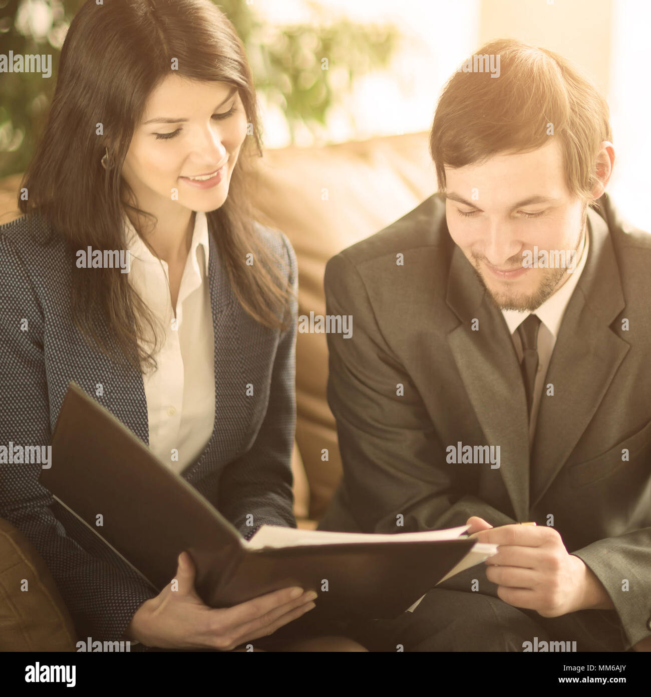 Image of business people listening and talking to their colleague at meeting - Stock Image