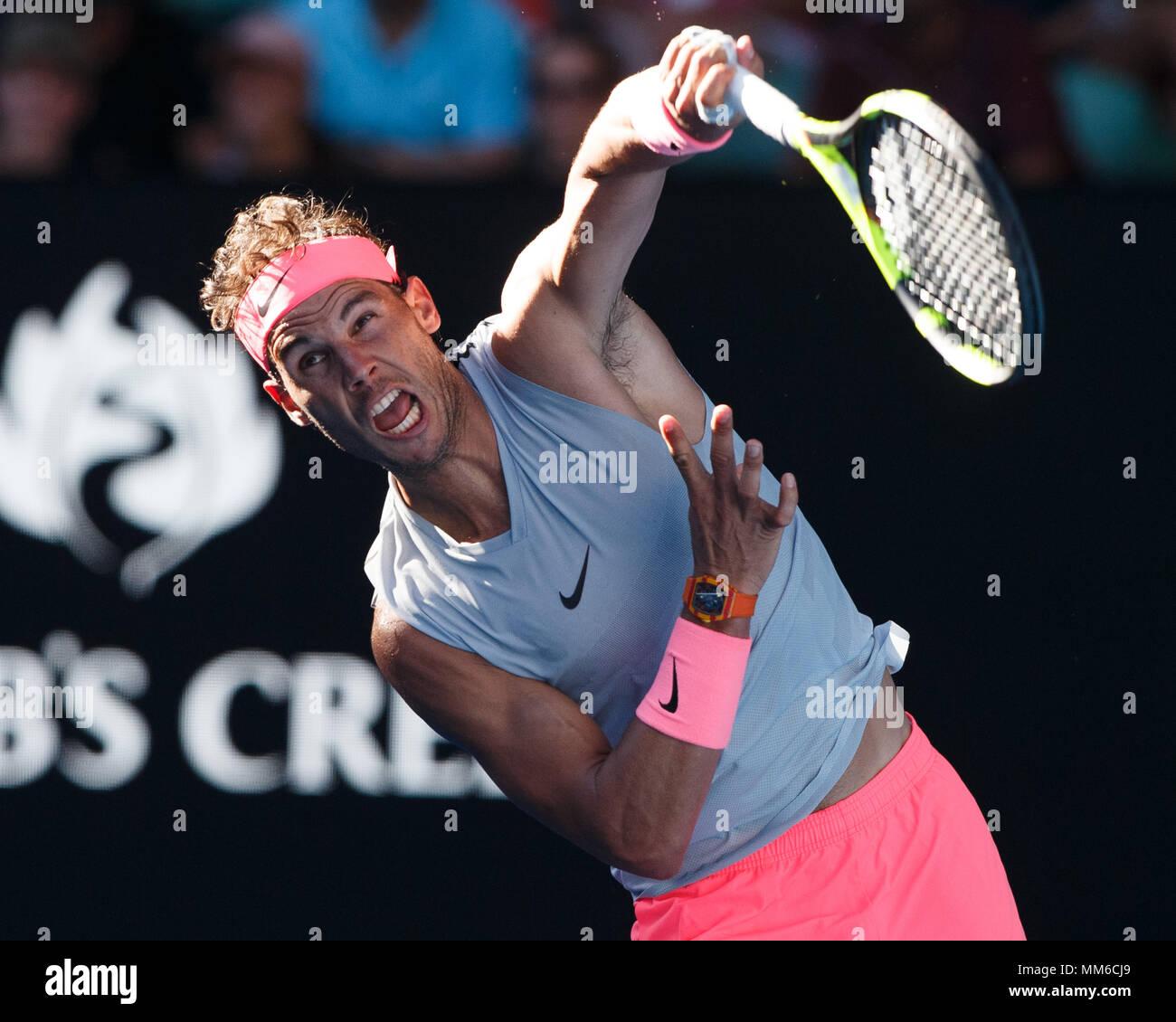 Spanish tennis player Rafael Nadal  playing service shot at Australian Open 2018 Tennis Tournament, Melbourne Park, Melbourne, Victoria, Australia. Stock Photo