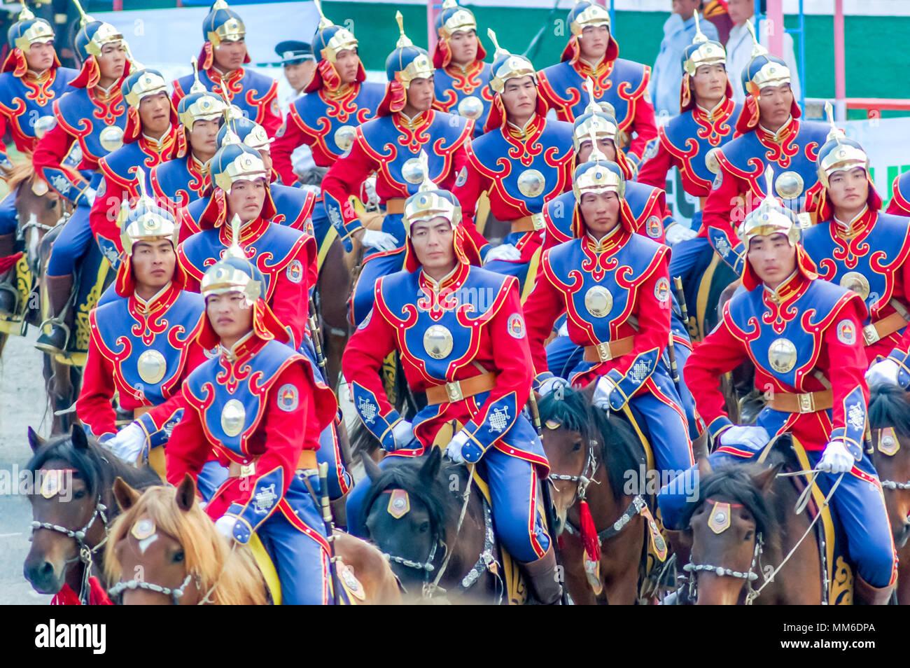 Ulaanbaatar, Mongolia - July 11, 2010: Uniformed horsemen in horseback riding display at Nadaam Opening Ceremony in capital Ulaanbaatar. - Stock Image