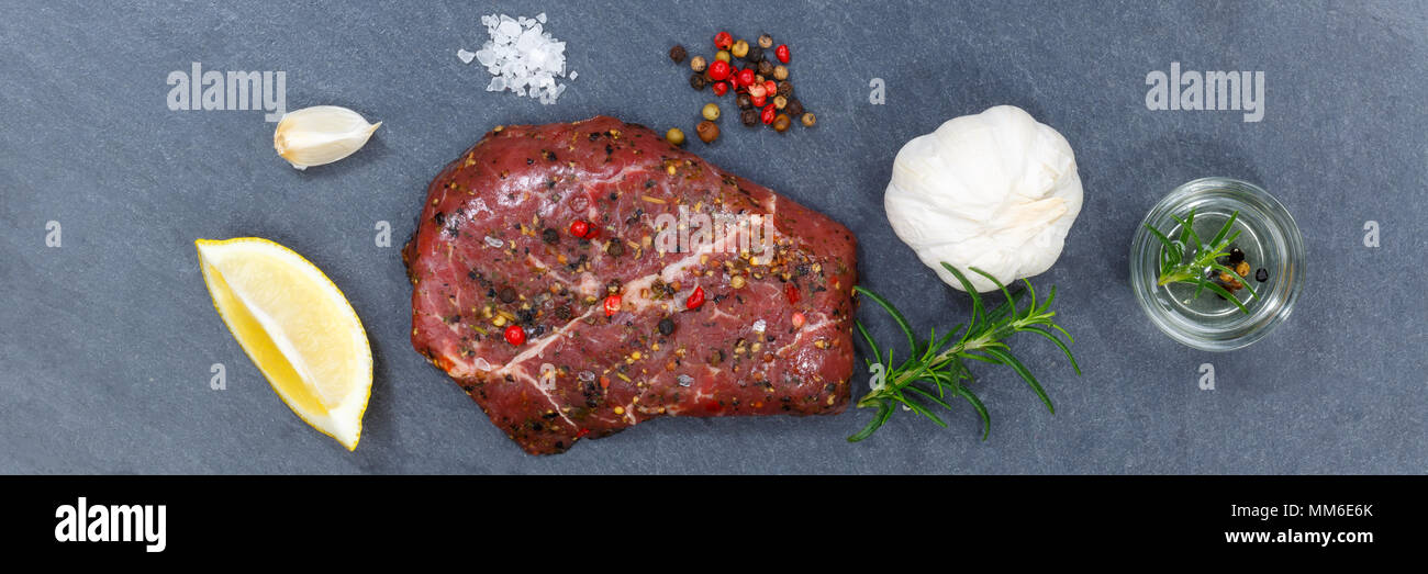 Meat raw beef steak banner from above slate top view - Stock Image