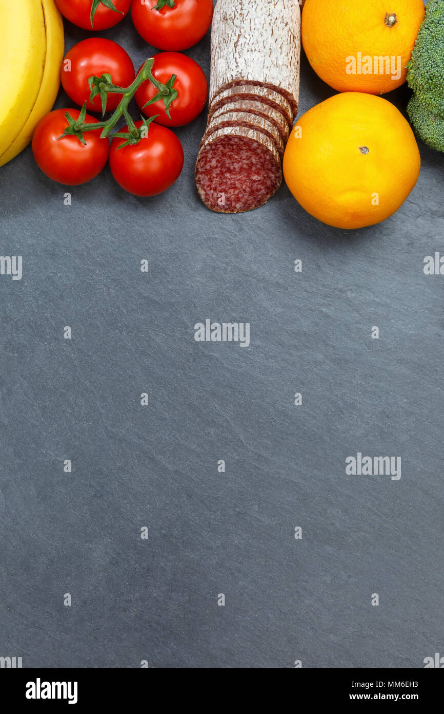 Fruits and vegetables food collection portrait format slate copyspace from above top view - Stock Image