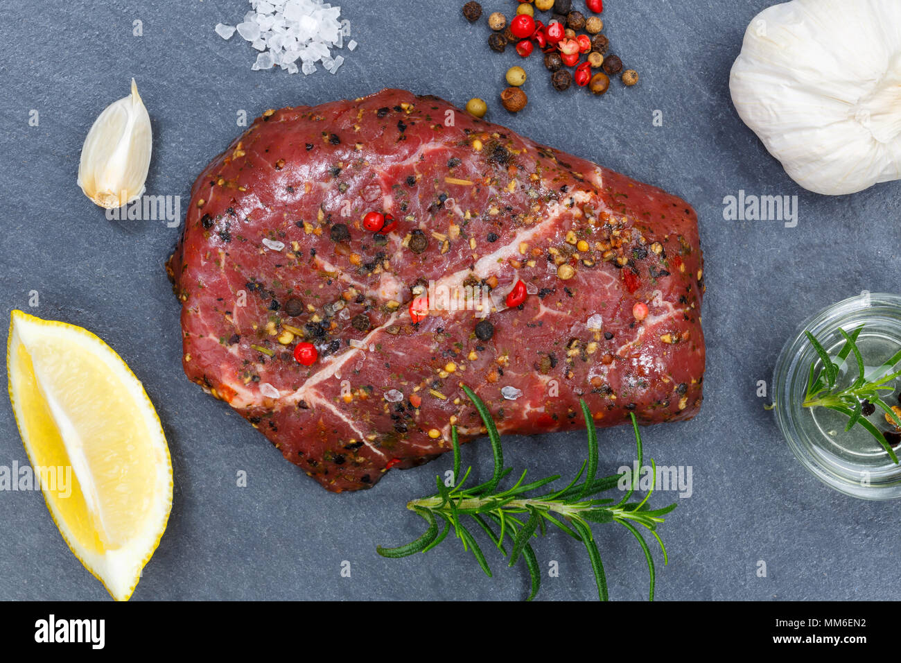 Meat raw beef steak from above slate top view - Stock Image