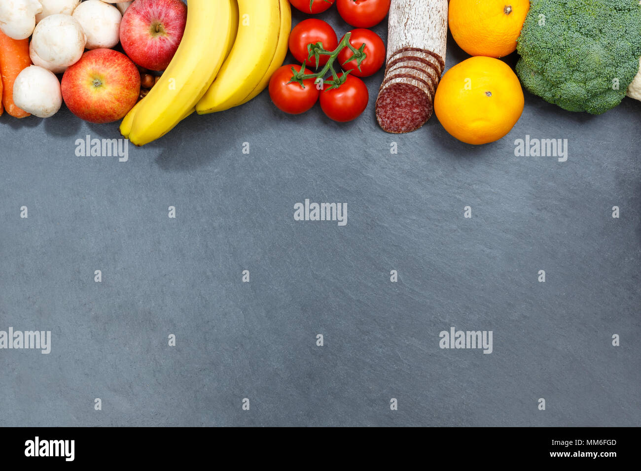 Fruits and vegetables food collection slate copyspace from above top view - Stock Image