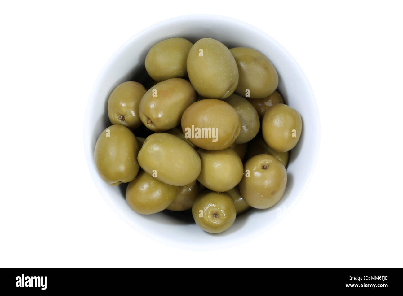 Olives green olive from above bowl isolated on a white background - Stock Image