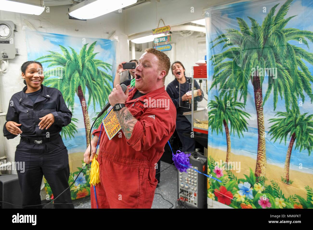 170907-N-GX781-1241 NORWEGIAN SEA (Sept. 7, 2017) - Electrician's Mate 2nd Class John DeCecco, from Harrison, New Jersey, sings during an open mic night held aboard the Arleigh Burke-class guided-missile destroyer USS James E. Williams (DDG 95), Sept. 7, 2017.  James E. Williams, home-ported in Norfolk, is on a routine deployment to the U.S. 6th Fleet area of operations in support of U.S. national security interests in Europe. (U.S. Navy photo by Mass Communication Specialist 3rd Class Colbey Livingston/ Released) - Stock Image