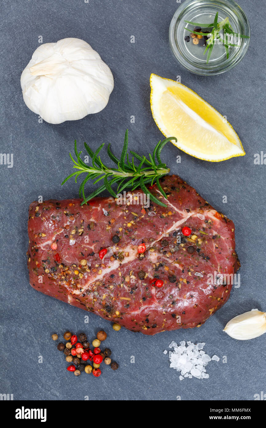 Meat raw beef steak portrait format from above slate top view - Stock Image