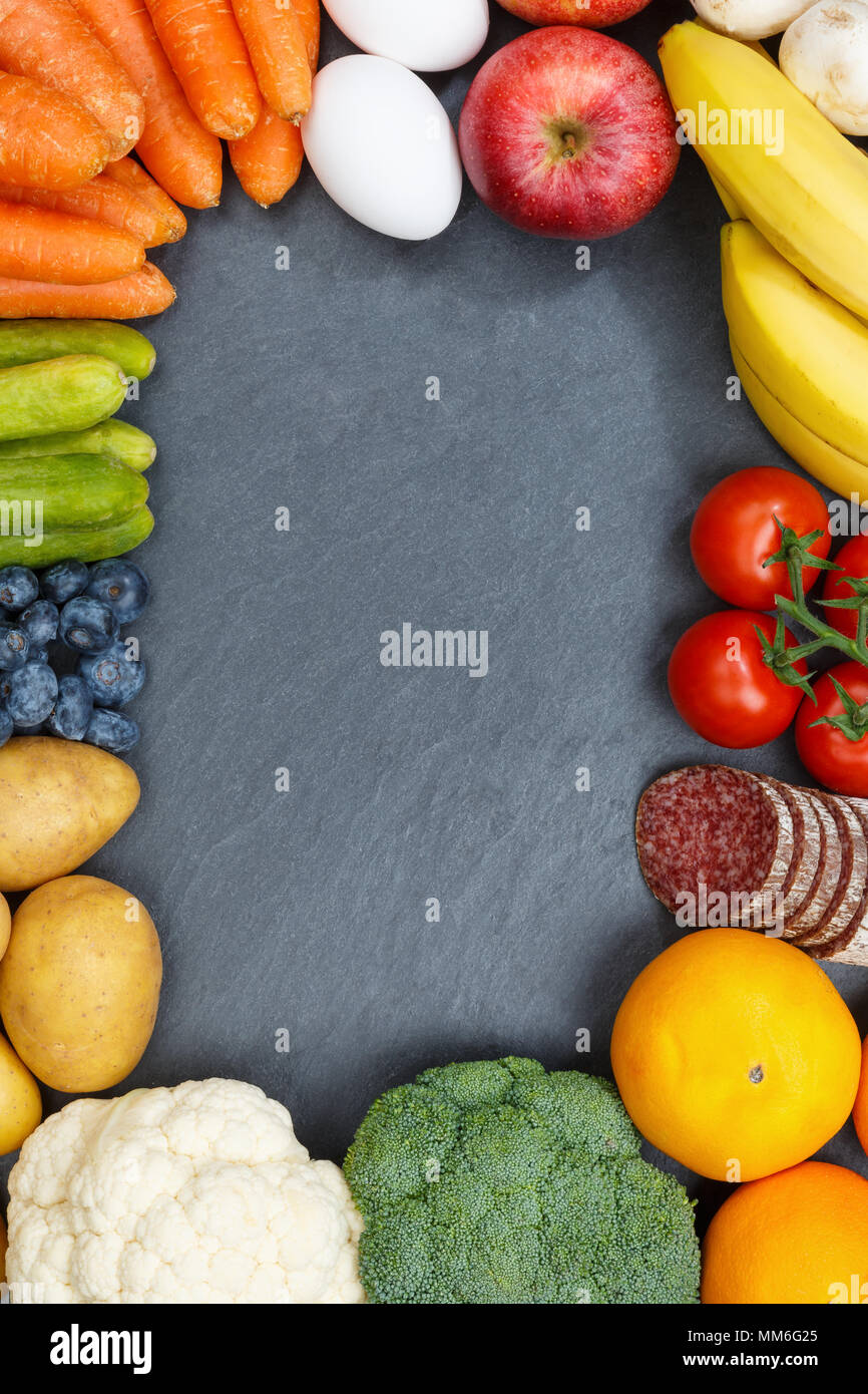 Fruits and vegetables food collection frame portrait format slate copyspace from above top view - Stock Image