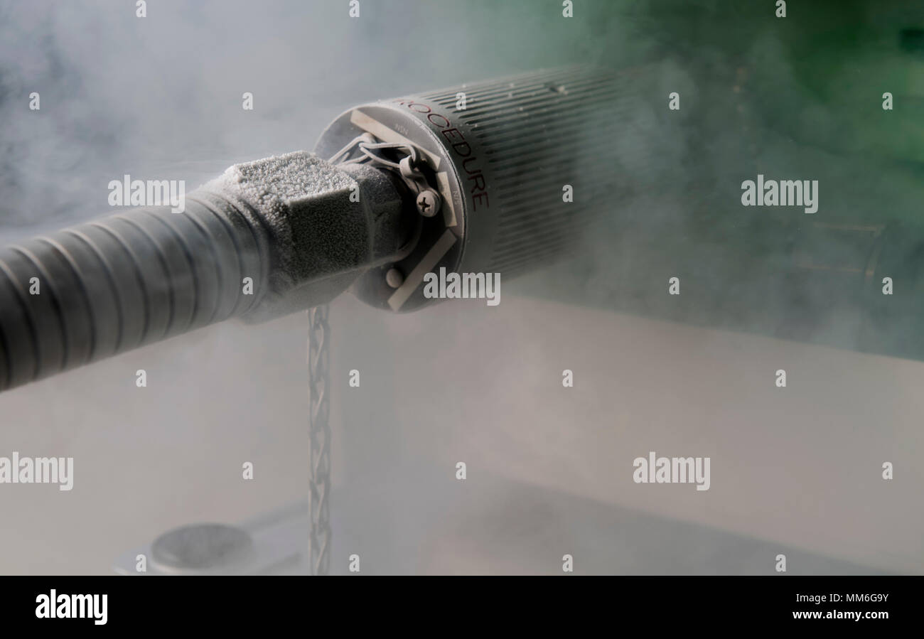 Ice forms around the hose of an oxygen generator and liquefier as it