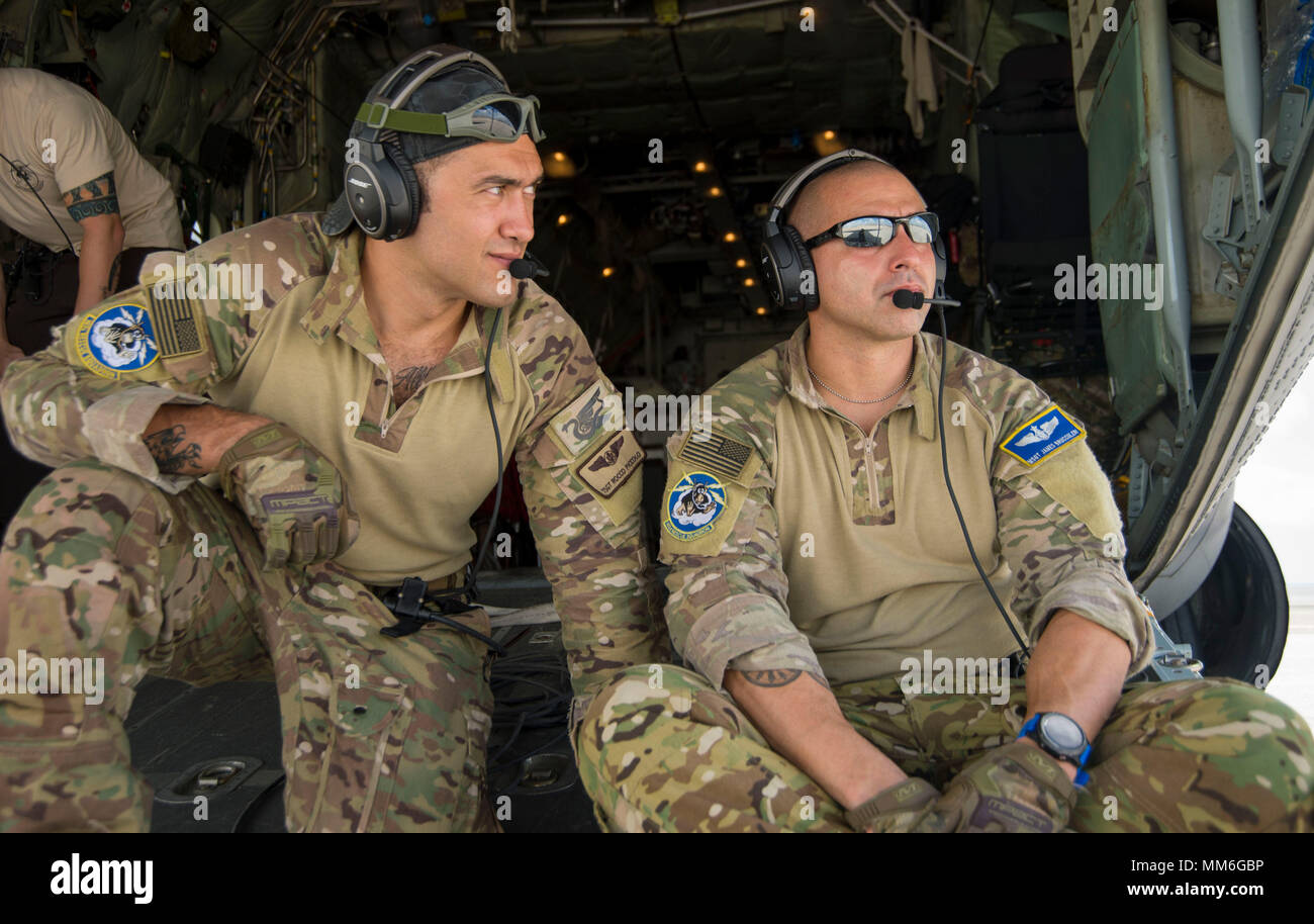 TSgt Rocco Piccolo and MSgt James Brucculeri, Loadmasters from the New York Air National Guard's 102nd Rescue Squadron get ready as they prepare to load 100 stranded evacuees from Princess Juliana International Airport on St. Maarten on Sept. 10, 2017.The New York Air National Guard's 106th Rescue Wing, staging out of San Juan, Puerto Rico with the 156th Air Lift Wing provide rescue support to those in need on St. Maarten. The 106th brought two HC-130 King aircraft, three HH-60 Pave Hawk helicopters, three zodiac boats and 124 Airmen required to carry out the mission. U.S. Air Force photo by S - Stock Image
