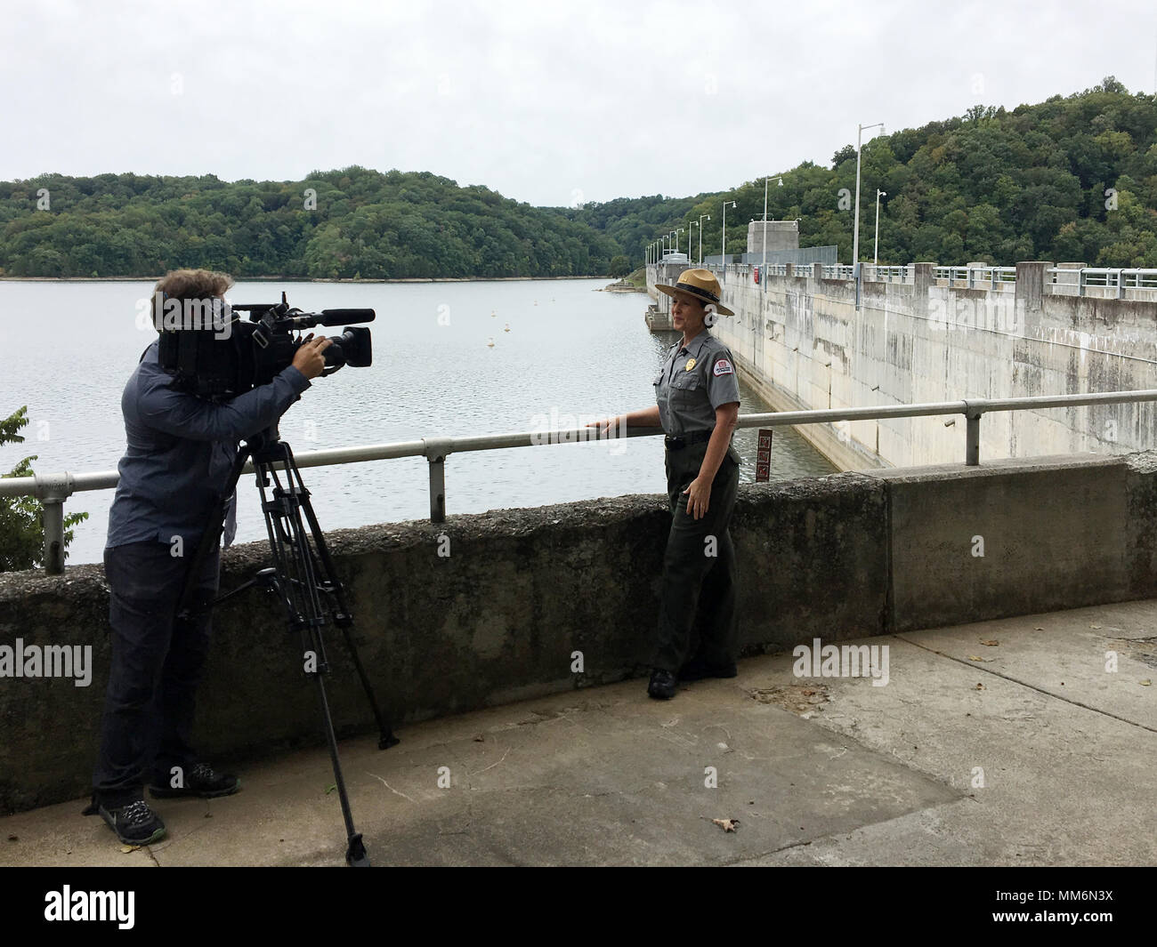 Paul Mojonnier, Tennessee Crossroads videographer, interviews Park Ranger Sondra Carmen Sept. 11, 2017 at Dale Hollow Dam in Celina, Tenn., for an upcoming episode in early 2018 for a feature as part of the dam's 75th anniversary, also in 2018. The program airs on Nashville Public Television. (USACE photo by Steve Crawford) - Stock Image