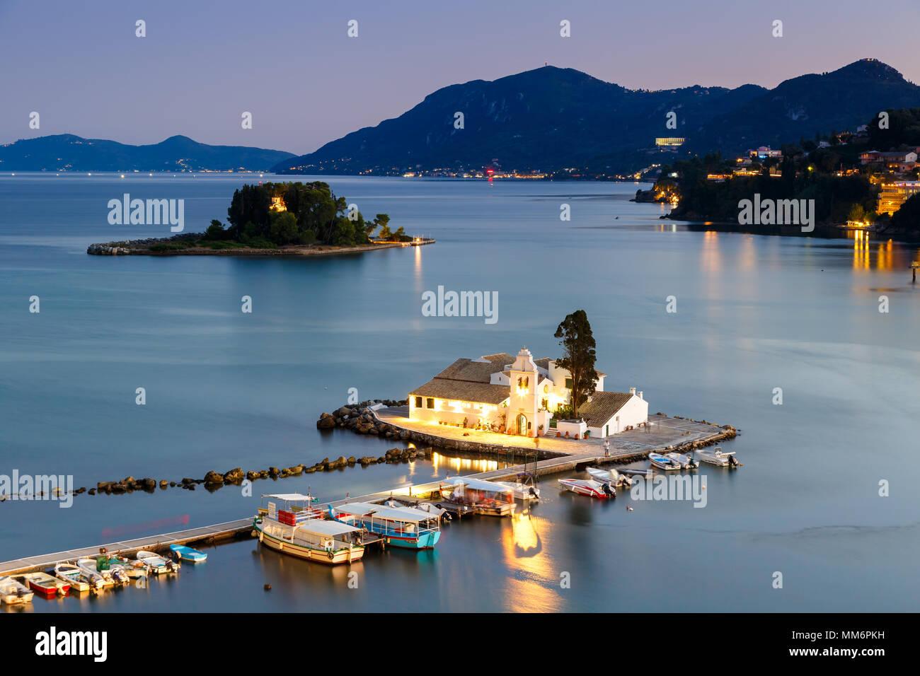Corfu Greece Vlachernon Vlacherna church blue hour Kanoni island traveling sea boat - Stock Image