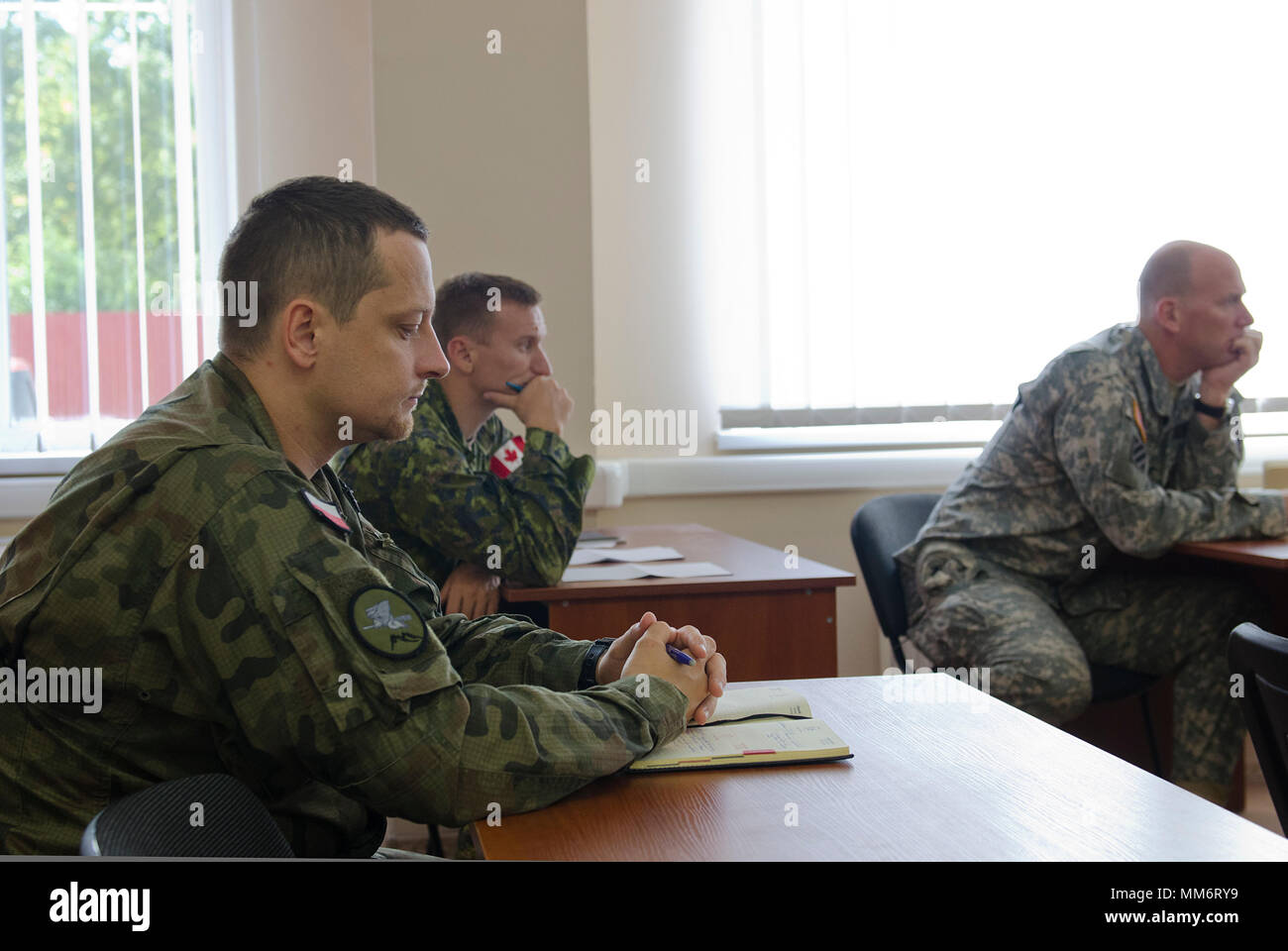 Canadian, Lithuanian, Polish and United States service members reviewed several local considerations in a civil affairs brief as part of Rapid Trident 17, Sept. 14, 2017, at the International Peacekeeping Security Center in Yavoriv, Ukraine. Stock Photo