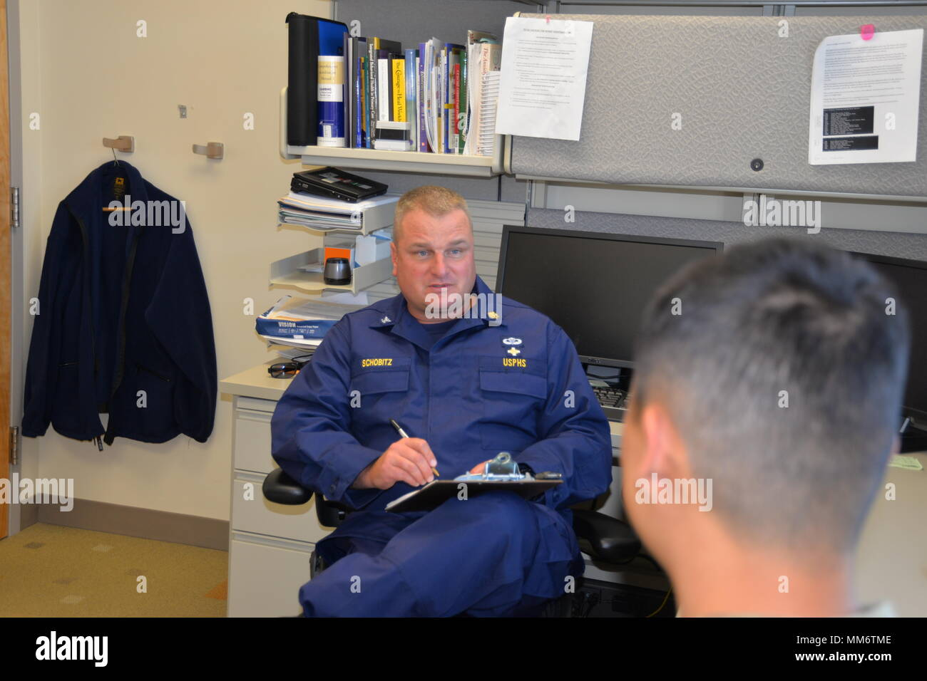 Capt. Richard Schobitz, chief of the Intensive Outpatient Behavioral Health Program and licensed clinical psychologist with the U.S. Public Health Service, talks to a Soldier in his office. The Intensive Outpatient Behavioral Health Program provides services and coping strategies to active duty members who have mental health issues, including anxiety, depression, post-traumatic stress disorder, or PTSD, and who have thoughts of committing suicide. (U.S. Air Force Photo by David DeKunder) - Stock Image