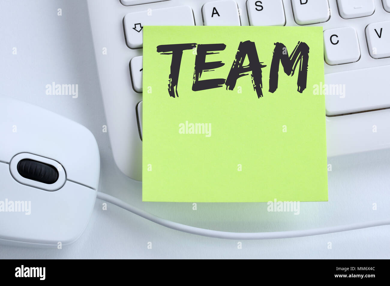 Team teamwork working together business concept office mouse computer keyboard - Stock Image