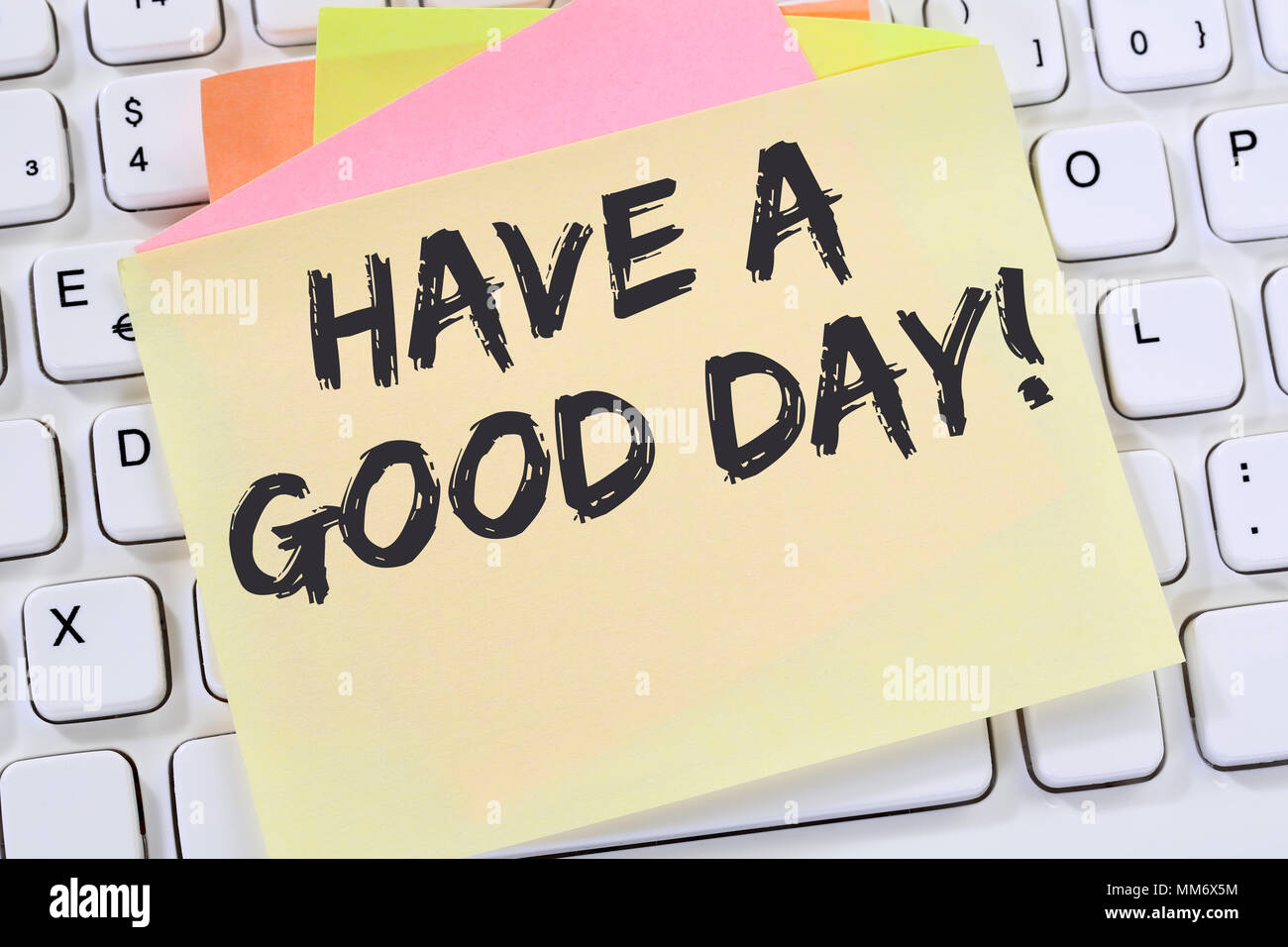 Have a good day nice wish work business concept note paper computer keyboard - Stock Image