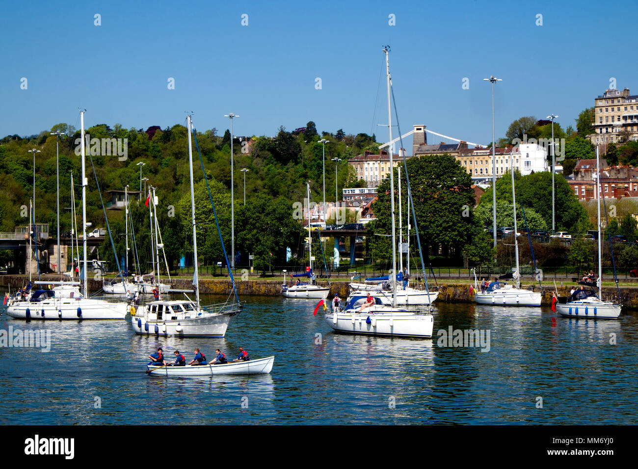 A flotilla of boats waits in the Cumberland Basin, Bristol for the second of two swing bridges to open enabling access to the city's Floating Harbour. - Stock Image