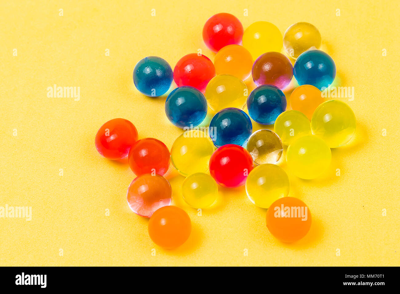 Gel multi-colored balls. Background made with scattered color gel balls - Stock Image
