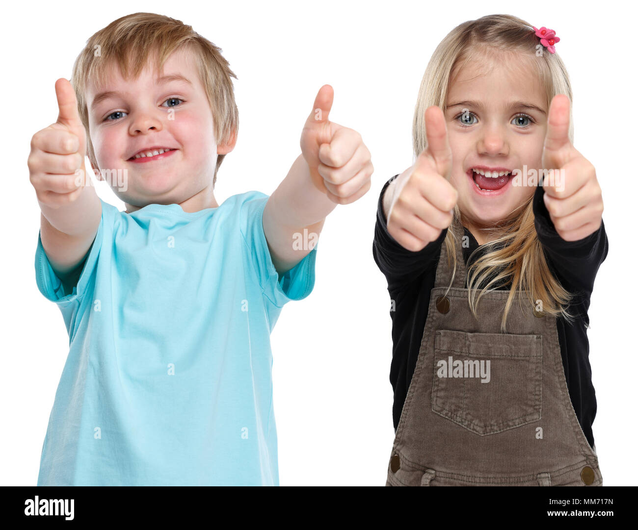 Children kids happy smiling success successful winner thumbs up isolated on a white background - Stock Image