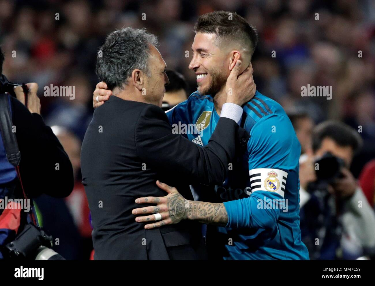 Sevillas coach joaquin caparros and real madrids captain sergio sevillas coach joaquin caparros and real madrids captain sergio ramos greet each other during the spanish first division league match between sevilla and m4hsunfo