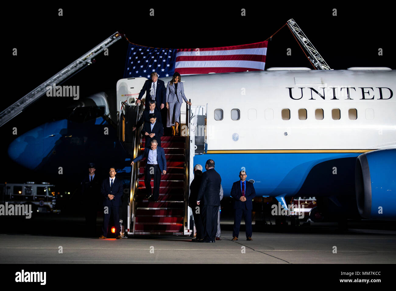 U.S. President Donald Trump and first lady Melania Trump arrive with three American detainees after their arrival from North Korea at Joint Base Andrews, Maryland, U.S., on Thursday, May 10, 2018. North Korea released the three U.S. citizens who had been detained for as long as two years, a goodwill gesture ahead of a planned summit between President Donald Trump and Kim Jong Un that's expected in the coming weeks. Credit: Al Drago/Pool via CNP /MediaPunch - Stock Image