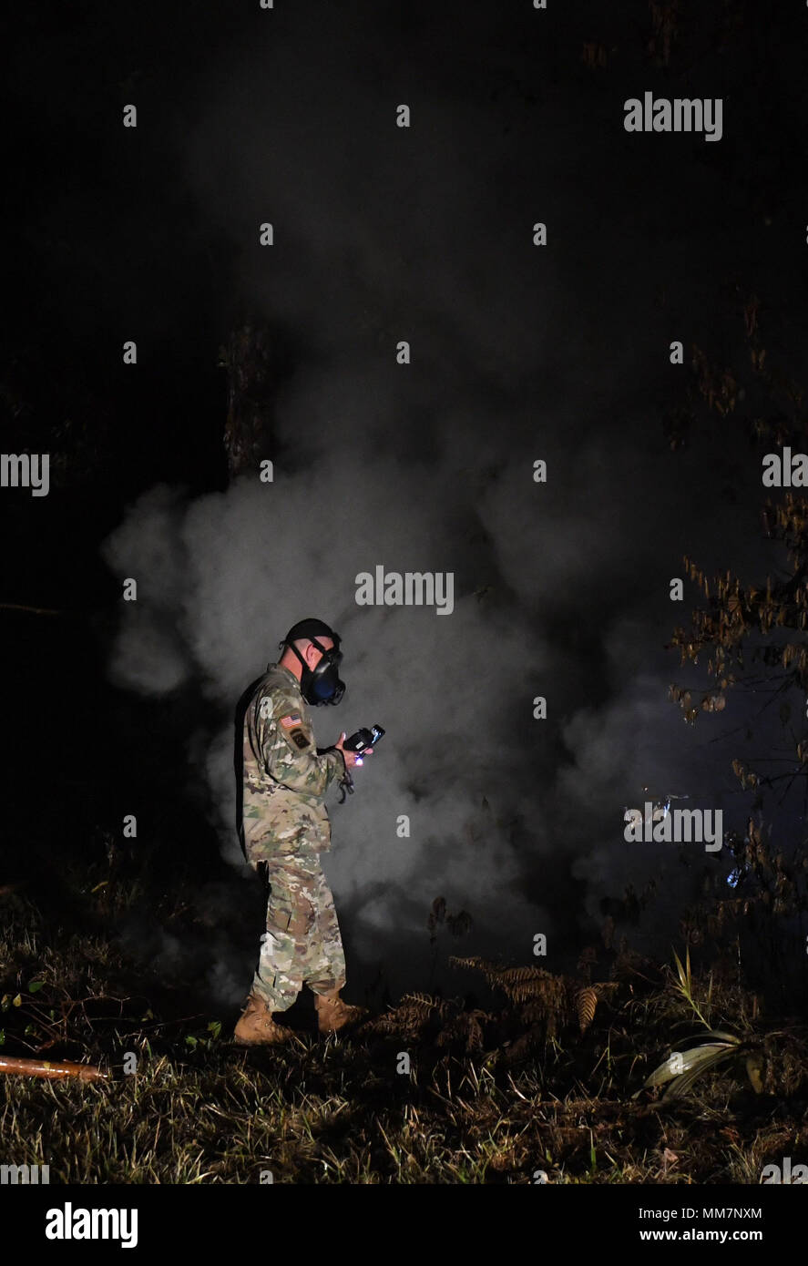 (180510) -- HAWAII, May 10, 2018 (Xinhua) -- A U.S.army officer checks on sulphur dioxide levels at the 13th fissure in Leilani Estate, Hawaii, United States, May 10, 2018. According to reports of the Hawaii State government, eruptions of the Kilauea Volcano had forced the evacuation of thousands of people. (Xinhua/Tao Xiyi) (zxj) - Stock Image