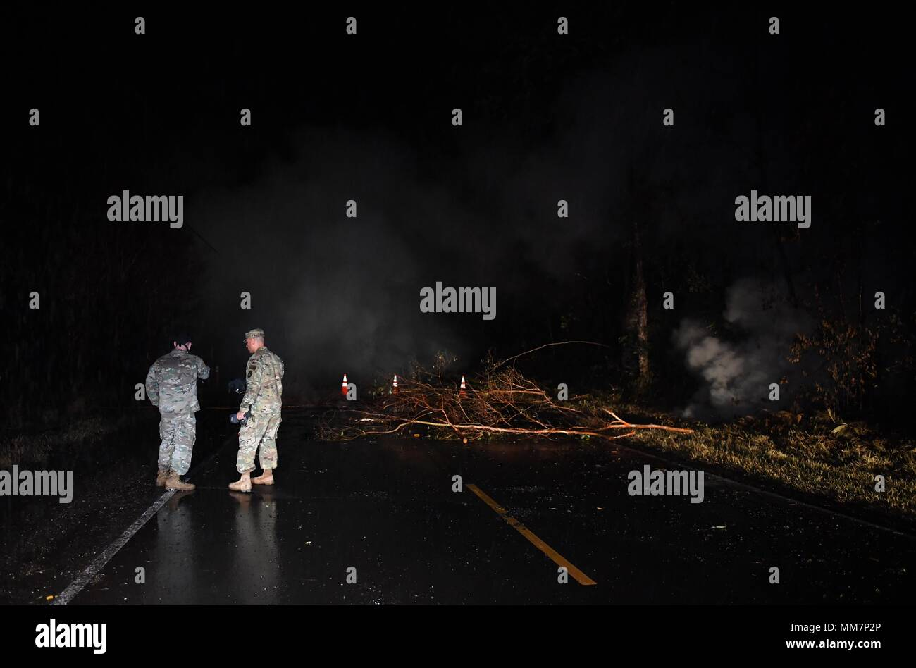 Hawaii, USA. 10th May, 2018. Two U.S.army officers check on sulphur dioxide levels at the 13th fissure in Leilani Estate, Hawaii, United States, May 10, 2018. According to reports of the Hawaii State government, eruptions of the Kilauea Volcano had forced the evacuation of thousands of people. Credit: Tao Xiyi/Xinhua/Alamy Live News - Stock Image