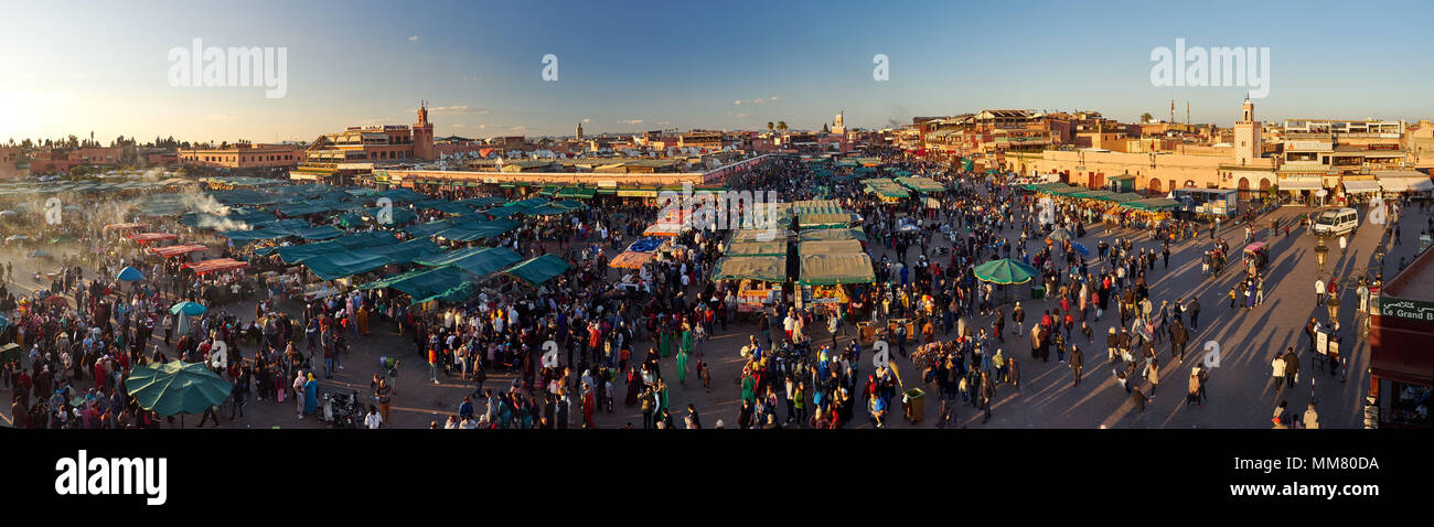 Square of Jemaa el-Fnaa, the soul of the city of Marrakech at sunset, photo panorama, Morocco. Stock Photo