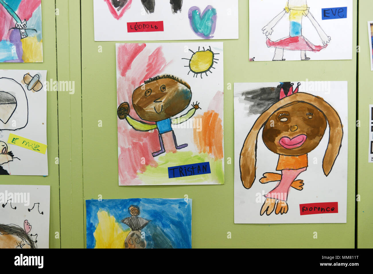 Children's art works on the wall in their school. - Stock Image