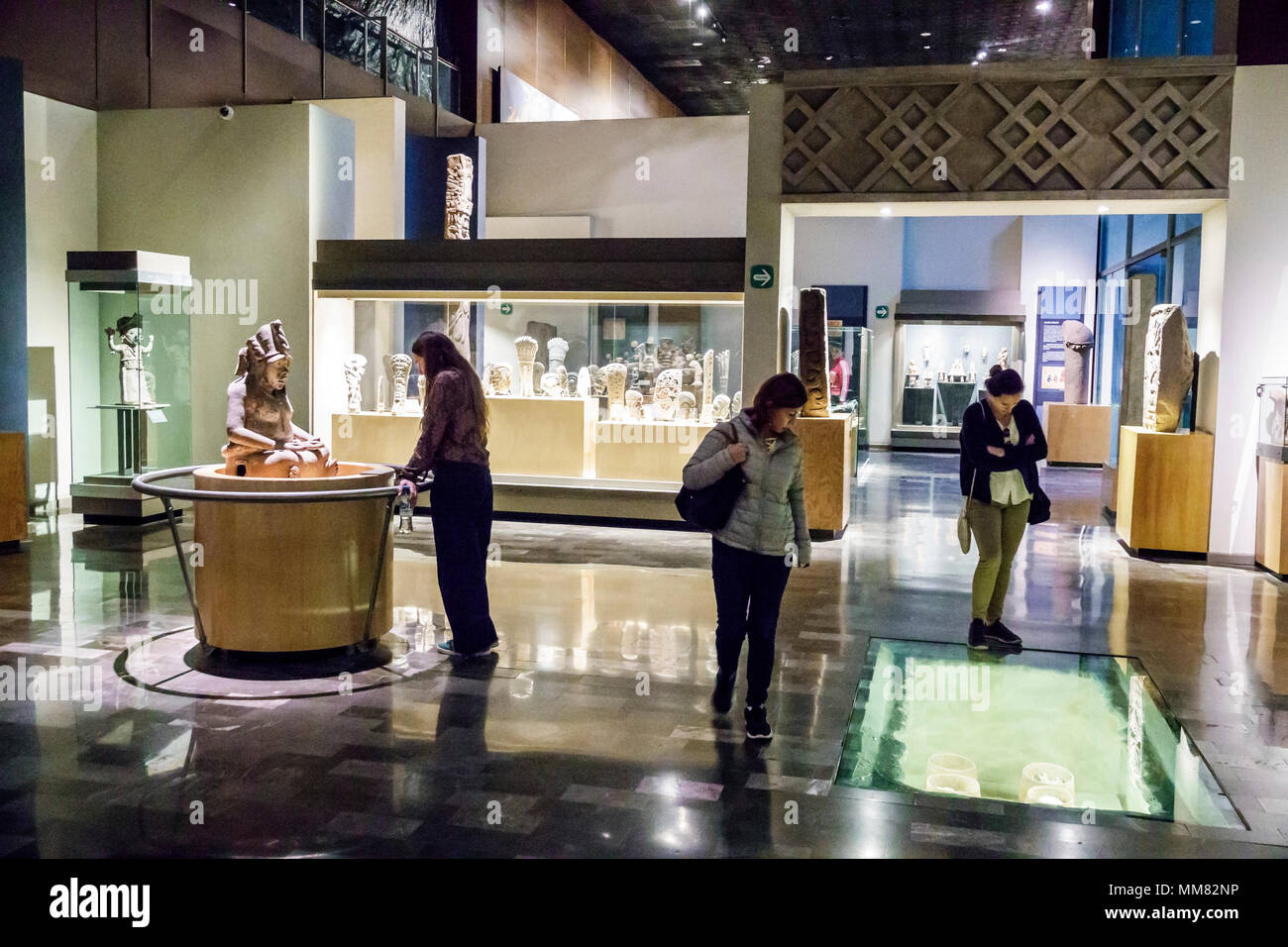 Mexico City Mexico Ciudad de Federal District Distrito DF D.F. CDMX Polanco Hispanic Mexican Museo Nacional de Antropologia National Museum of Anthropology interior exhibit Tlazolteotl clay sculpture woman looking North America American - Stock Image