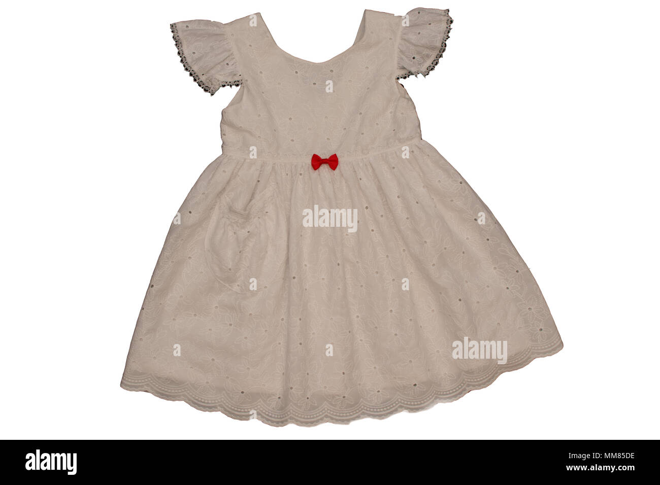 hand made and embroidered children dress with tie and glitters - Stock Image