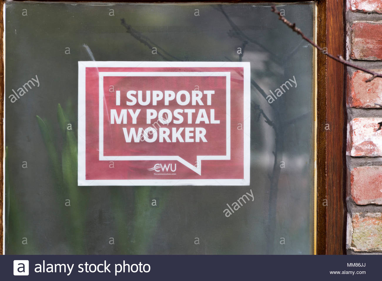 I Support My  Postal Worked - a CWU poster stuck inside a window, Blandford Forum, Dorset, England - Stock Image