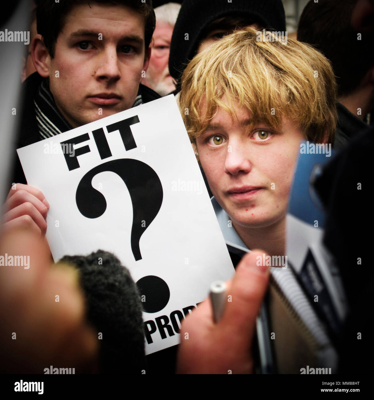 A young supported protests against the ownership of Portsmouth FC, questioning whether it passes the 'fit and proper' test that all new owners must pas under Premier League and Football League rules. The protest occured before Portsmouth played Sunderland AFC in the FA Cup 4th Round in 2010 - Stock Image