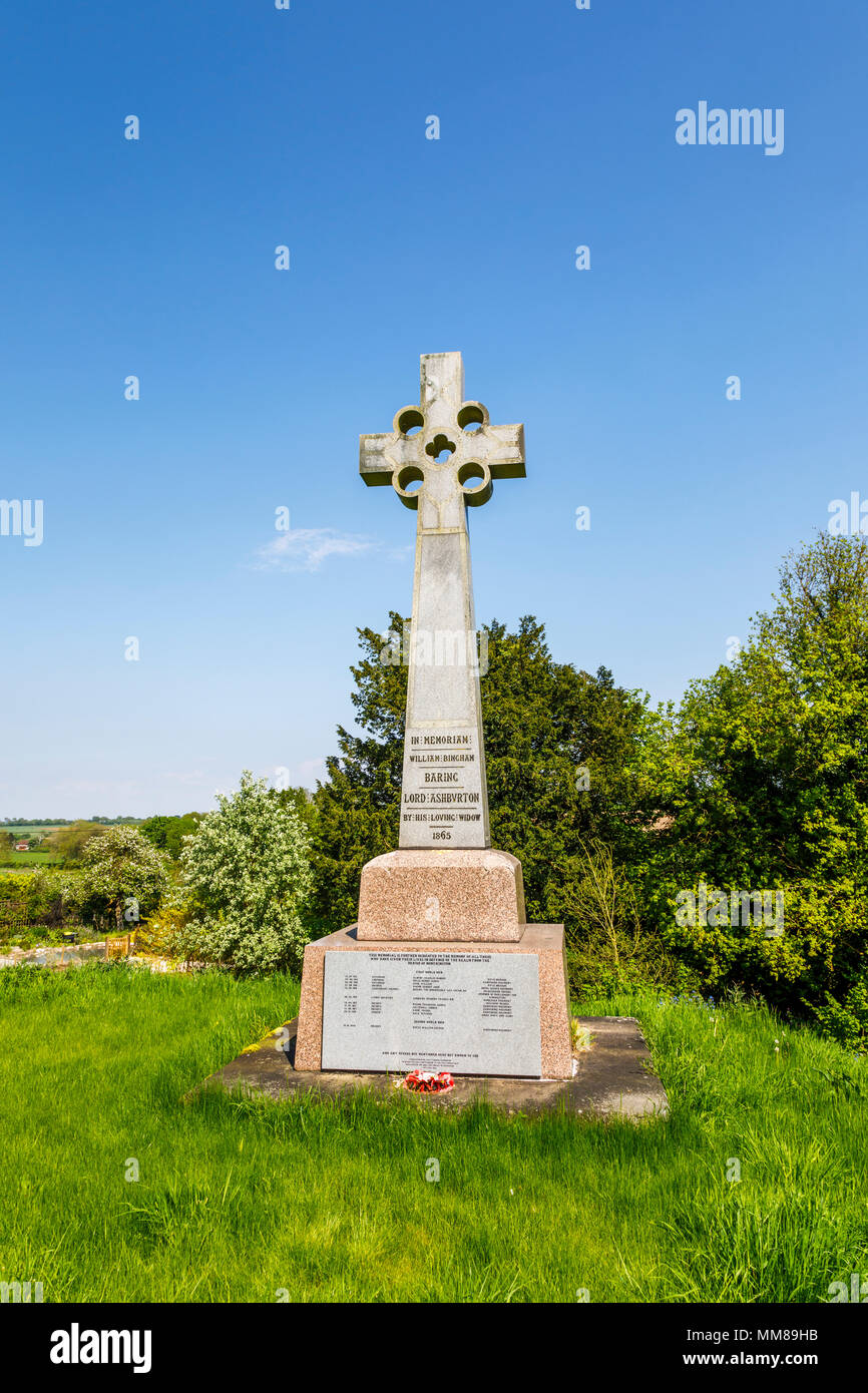 Memorial to Lord Ashburton and war memorial in Northington, a small village in Hampshire, southern England, near Winchester on a sunny spring day - Stock Image
